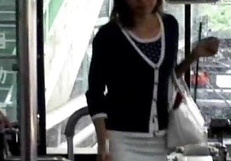 A young Asian girl enters a public bus and sits down from http://alljapanese.net - 56 sec
