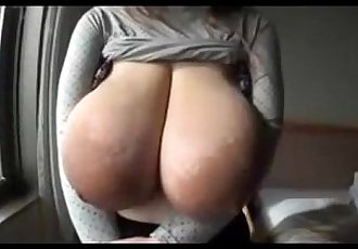 Asian Chick shows off insanely massive tits - 7 min