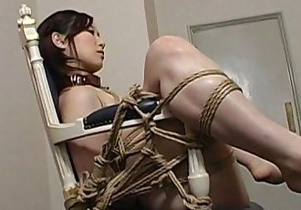 Extreme bondage and dildo fuck for an Asian babe - 5 min