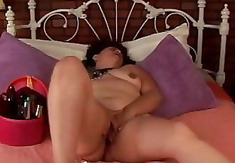 Cute and cuddly mature amateur fucks her fat juicy pussy to
