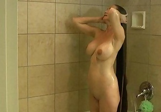 busty longhair blonde milf shampooing in the shower - 1 min 6 sec