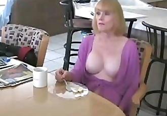 He fucks a mature mom in kitchen