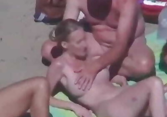 Strangers come to cuckold couple on nude beach, wife jerks them off