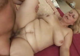 Blonde granny wakes him up for an anal fuck