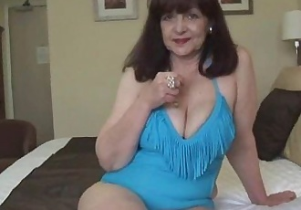 Attractive big tits mature lady in tight swimsuit playing on fitness ball - 7 min