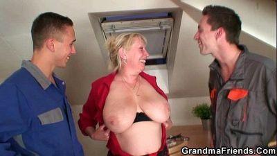 Naughty granny pleases two repairmen - 6 min