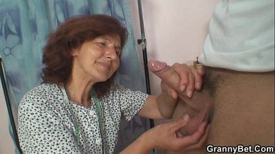 Sewing granny enjoys riding young cock - 6 min