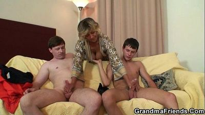 Two young dudes bang old mom - 6 min