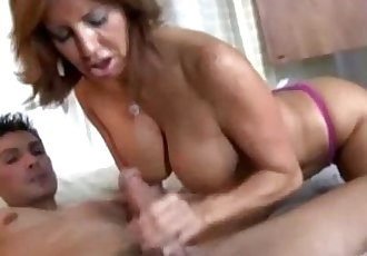 Horny old MILF tugs cock like a pro