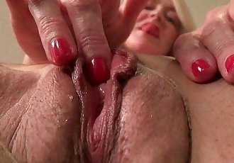 American milf Eva Griffin fingers her nyloned wet pussyHD