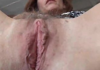 Mature redhead fucks her pussy and asshole - 5 min