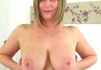 British milf April takes a masturbation break