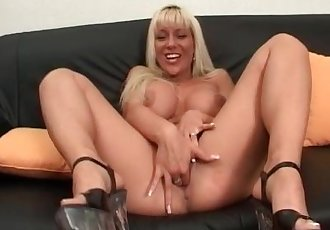 Big boobed blonde gives hot blowjob