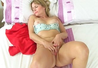 British milf Ila Jane strips off and plays