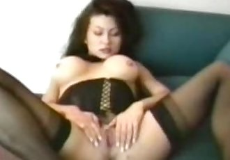 Big breasted milf plays with herself