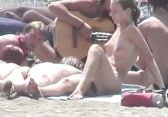 Young nudists sun taning
