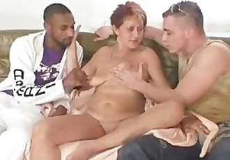Naughty granny takes two cocks at once