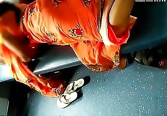 Desi beautiful Indian Aunty showing her beautiful legs from saree in train 27 sec