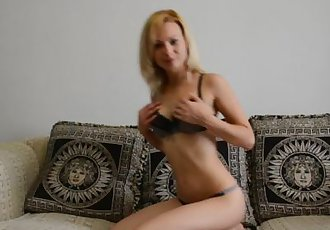 Absolutely stunning blonde stripping and teasing