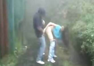 indian Lovers making-out in rain outdoor