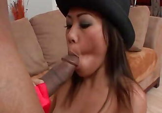 Stunning Asian babe rides monster black cock