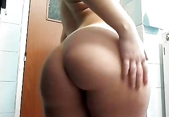 cute amateur oils up her big ass and tits