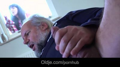 Old perv caught watching porn and masturbating gets fresh pussy rubbing