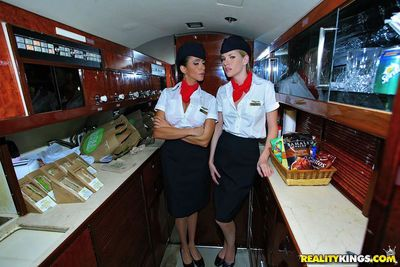 Sexy flight attendants in stockings fucking first class passanger