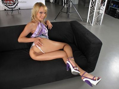Hot blonde Blue Angel in heels on her knees spreading wide & fisting pussy
