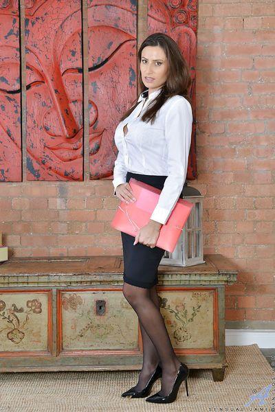 Mature brunette Latina Sensual Jane freeing big tits from office clothes
