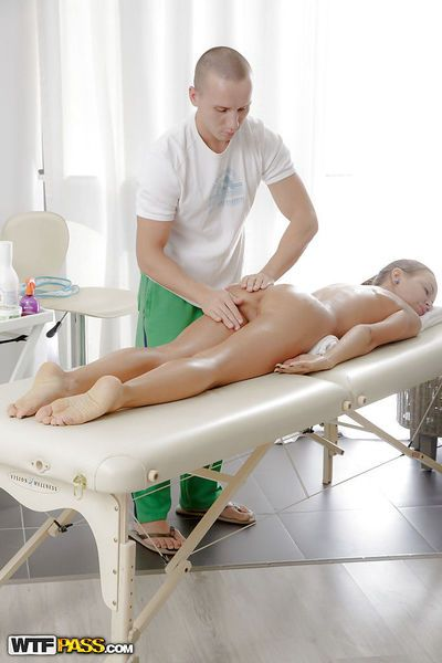 Hot masseur is doing an relaxing massage to an oiled beauty Carre