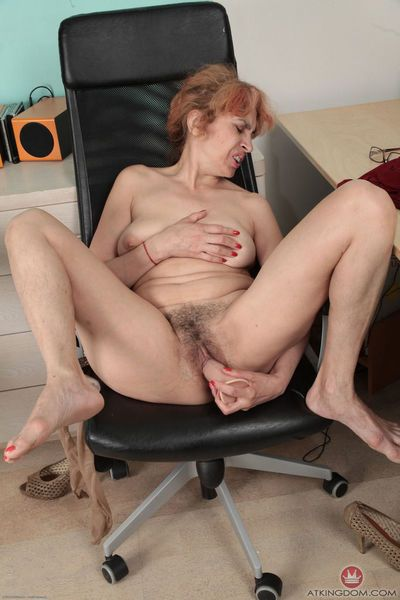 Mature chick gets naked in the office and fucks herself with a dildo toy - part 2