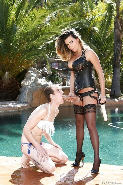 Fetish girl Danica Dillon in leather & strapon pegging sissy man in stockings