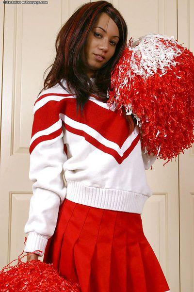 Amateur teen babe Mya Mason undresses her red cheerleader uniform