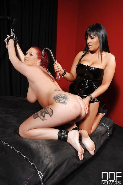 Lesbians Paige Delight & Jasmine Black engage in hard BDSM sex play in dungeon - part 2