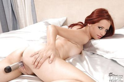 Nude redhead hottie with flawless tits toying her inviting pussy