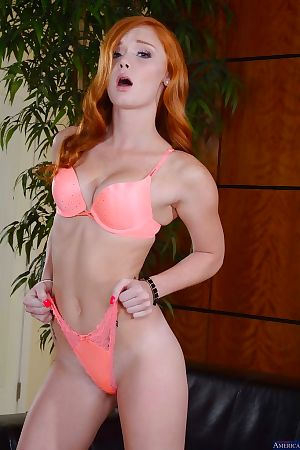 Tiny tits redhead Alex Tanner reveals her sexy ass in high heels