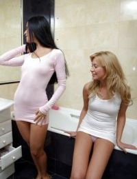 Luscious teenage lesbians licking and toying each others slits in the bath
