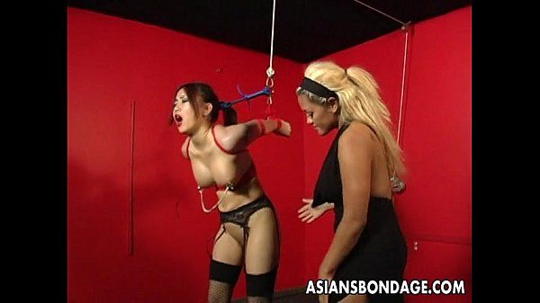Bound Asian lass is clamped and toyed as she hangs