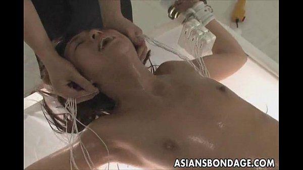 Japanese fucked by a big dildo bondage