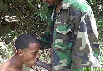 Handsome soldiers having gay oral fun