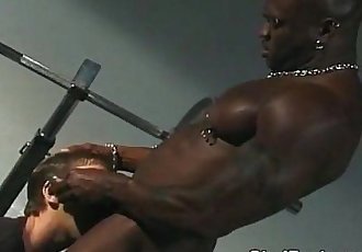 Interracial gay sex on the bench press