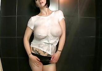 wet t-shirt slut shows off huge tits and perky nipples