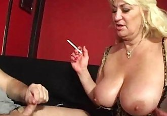 Big titted mature loves smoking and sucking - 6 min