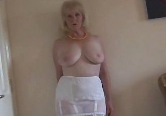 Mature busty lady in stockings and sheer slip strips - 7 min