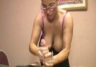Spex milf tugging dick before cumshot