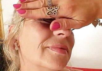 Well-endowed grandma penetrates a milf - 6 min