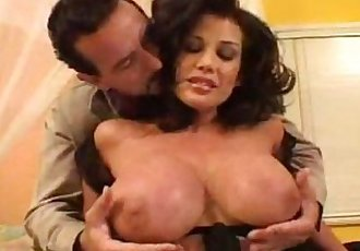 Awesome brunette milf with huge boobs