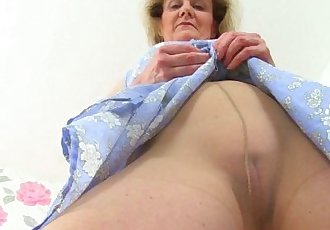 British granny Clare Cream lowers her tights and plays