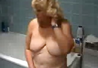 Granny teasing in the bathroom